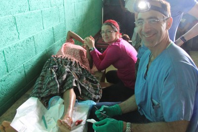 Dr. Jerry Brewer performs a surgery on a Guatemalan woman.