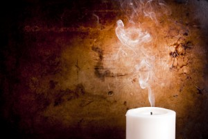 Smoke trails in smooth lines from a blown out candle with a vintage background