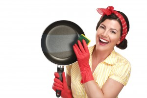 young beautiful woman housewife showing perfect washed dishes on white