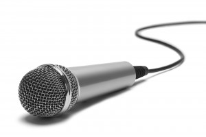 Silver Music Microphone with Cord Isolated on White Background.