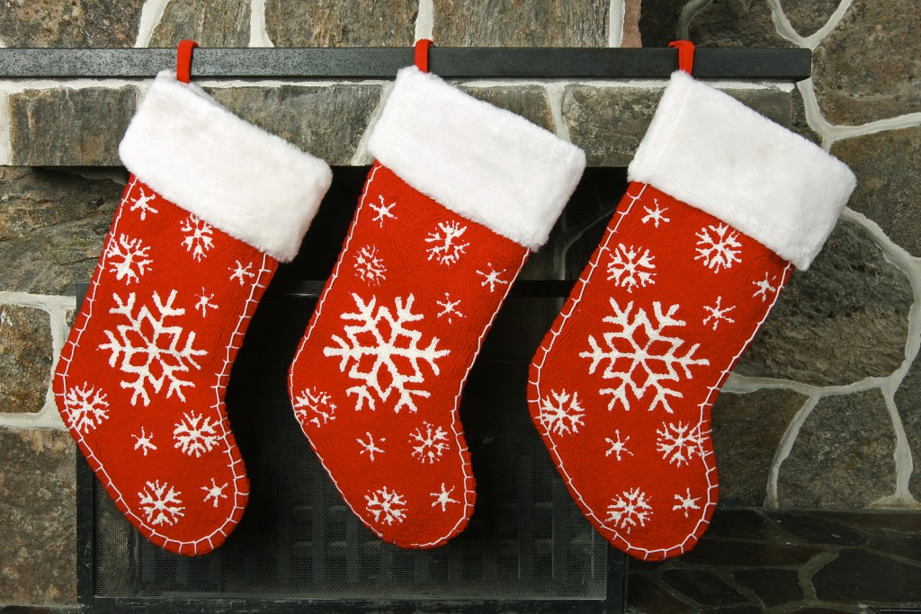 Christmas stockings on a old fashioned fireplace mantel