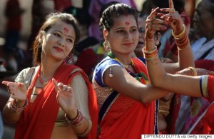 Indian Nepali Hindu devotees wear red and dance as they pay homage to Shiva, the Hindu god of destruction, during the Teej festival at the Durgagari Temple in Siliguri on September 16, 2015. The three-day long Teej festival, celebrated by Hindu women in Nepal and some parts of India, is observed by married women with fasting during the day and praying for long lives for their husbands, while unmarried women wish for handsome husbands and happy conjugal lives. AFP PHOTO / Diptendu DUTTA        (Photo credit should read DIPTENDU DUTTA/AFP/Getty Images)