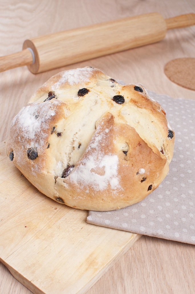 Traditional irish soda bread with raisins on the wooden board