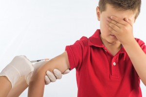 macro photograph of a doctor vaccinating a child