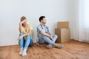 people, relationship difficulties, divorce, conflict and family concept - unhappy couple having argument or break up at home