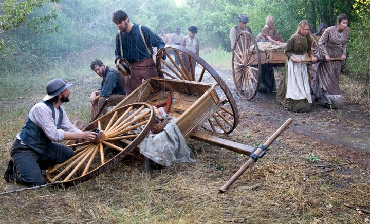 Brinley_Bywater_pulls_a_handcart_through_deluge_of_rain