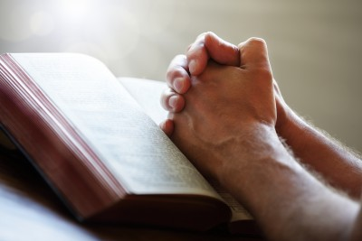 Hands folded in prayer.
