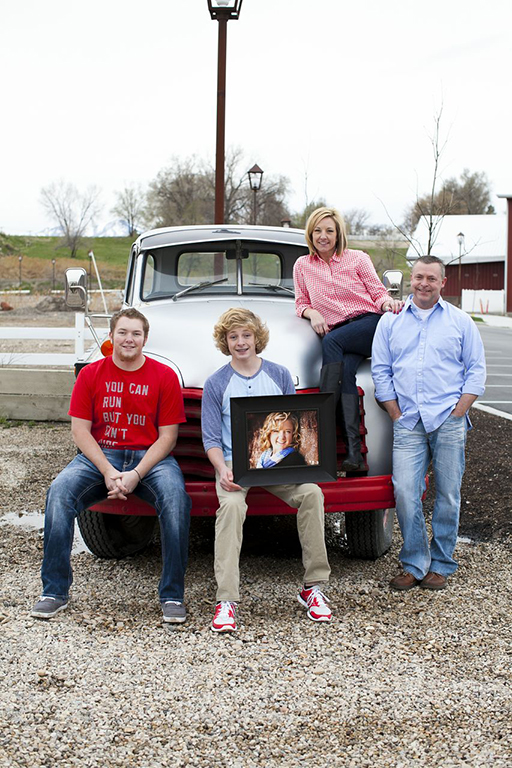 Jackie w family w pic of dau on mission when Riley was diagnosed w cancer