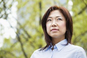 Portrait of an Asian woman outdoors. Horizontal shot.
