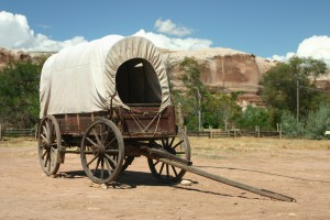 a covered wagon with white top in bluff utah